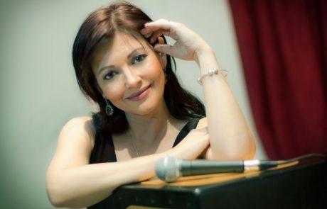 Певица Юлия Шмидт Быховская — «выпускница» программы «Первый дом на Родине» 2000  года